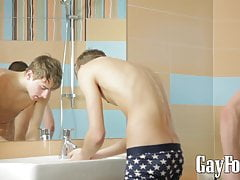 Kinky twinks pounding bareback in shower after deepthroat