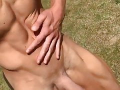 Fit lad walking and getting it out